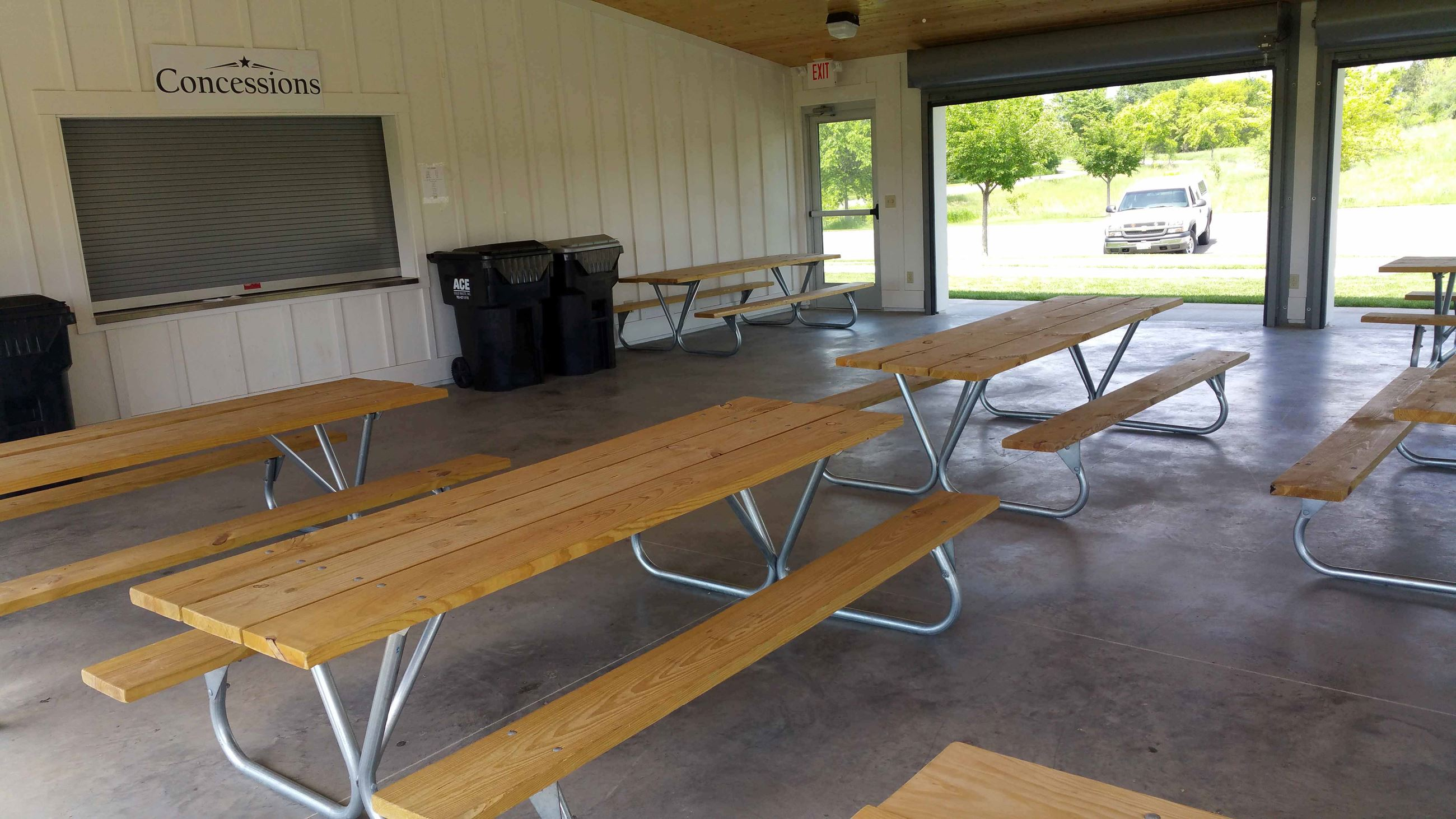 The seating area is outfitted with moveable tables, concession stand, and fireplace. The area has a